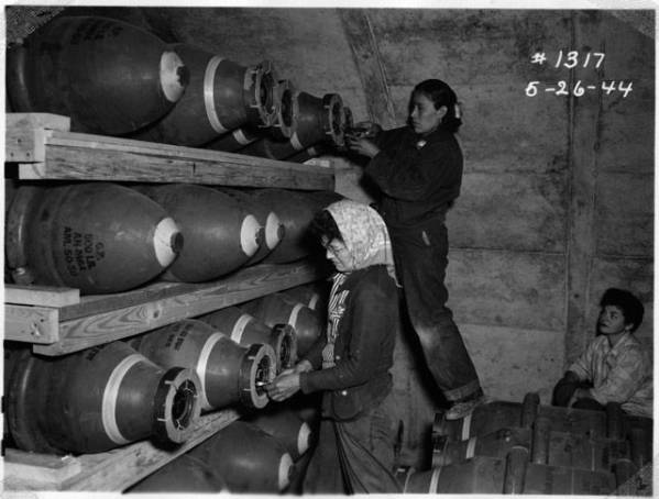 Photo of Navajo women stack munitions