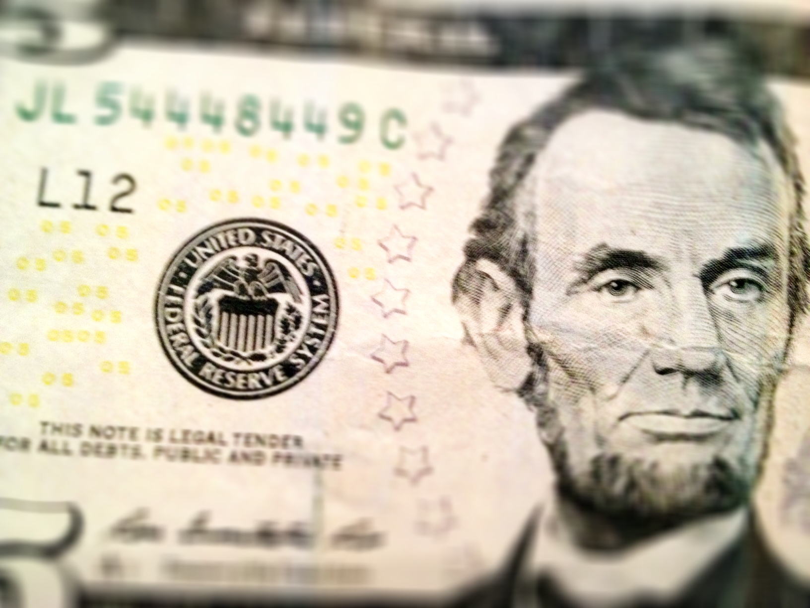Photo of five dollar bill